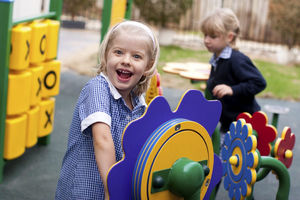 Close-up of a girl playing in a modern, accessible playground