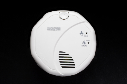 Close-up of a carbon monoxide (CO) detector on a black background